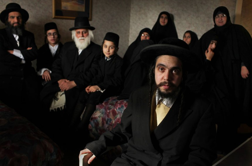 """Nachman Helbrans (front), son of group founder Rabbi Shlomo Helbrans, said, """"We were speaking with lawyers and organizations — especially the Home School Legal Defense Association and many associations associated with them — and all of them tell us that we must leave Quebec."""""""