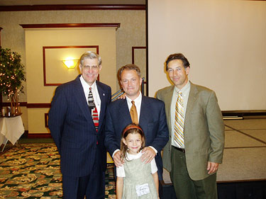 HSLDA President J. Michael Smith, Doug and Jubilee Phillips, and HSLDA board member Dick Honnaker at HSLDA's 2004 National Leadership Conference in Spokane, Washington.