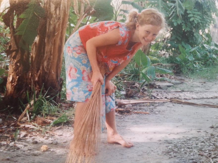 We daily swept dirt out with coconut brooms. Here's me sweeping the path behind our house.