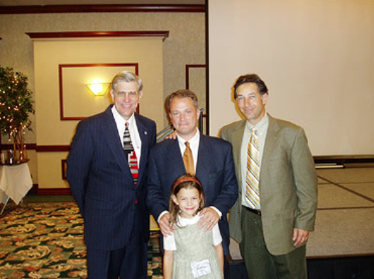 In 1994, Doug Phillips played a central role in HSLDA's efforts against H.R. 6, a bill that sent cataclysmic divisions throughout the U.S. homeschooling movement. Pictured, left to right: HSLDA President J. Michael Smith, Doug and Jubilee Phillips, and HSLDA board member Dick Honnaker at HSLDA's 2004 National Leadership Conference in Spokane, Washington.