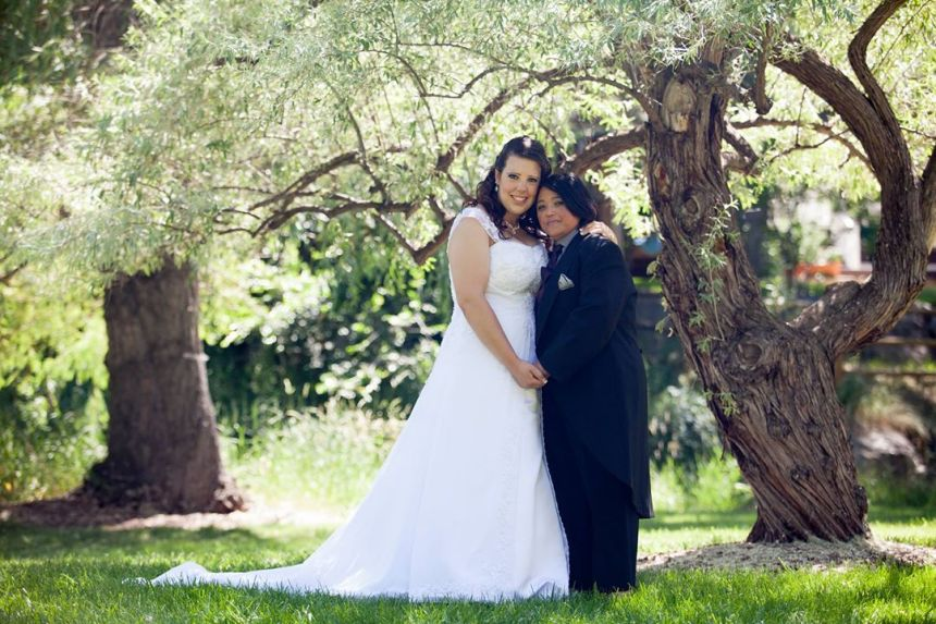 Amber and her wife, Clara on their wedding day.