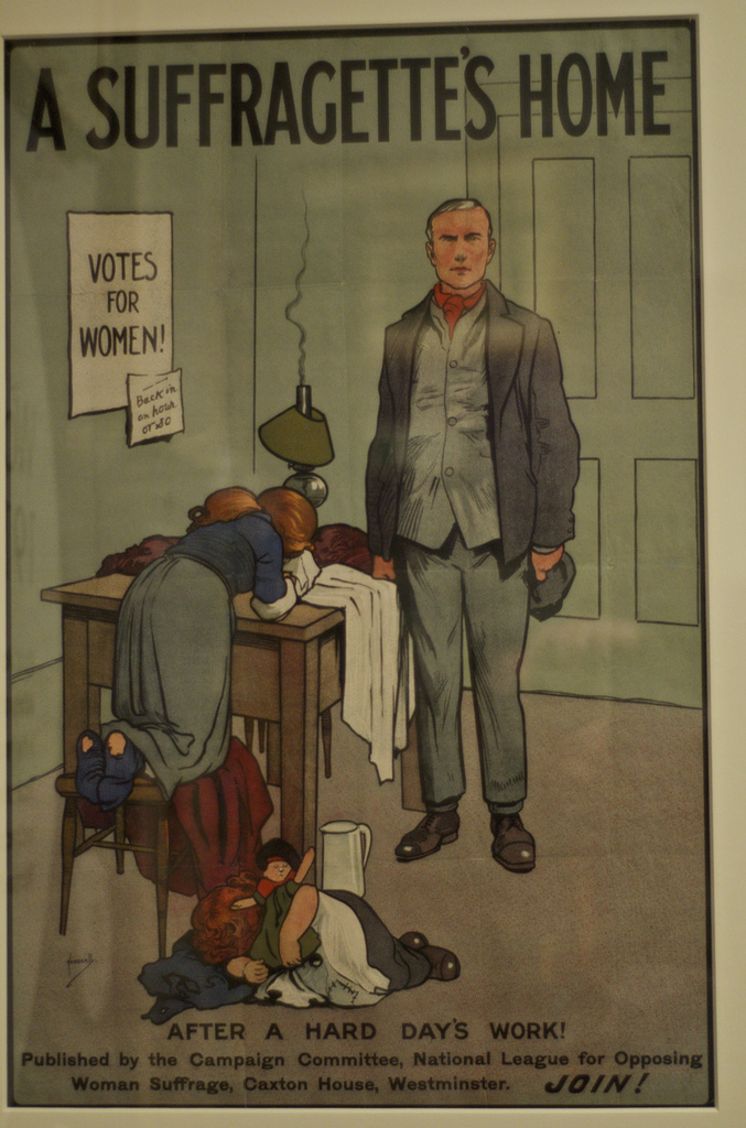 An anti-suffragette poster from the early 1900s entitled The Suffragette's Home. The poster depicts a home in disarray and an overwhelmed woman.